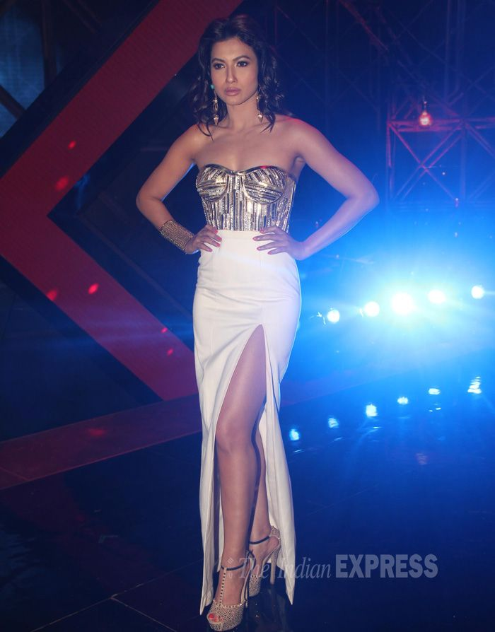 Host Gauhar (Gauahar) Khan was all decked up in a strapless Swapnil Shinde creation with a thigh-high slit on the sets of 'India's Raw Stars'. #Bollywood #Fashion #Style #Beauty