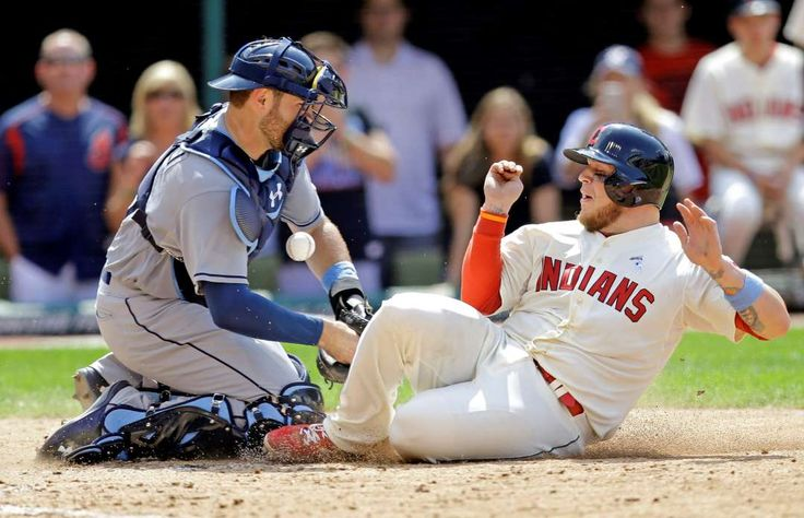 One run's enough -  Cleveland Indians' Roberto Perez slides safely into home plate as Tampa Bay Rays catcher Curt Casali drops the ball in the ninth inning on Sunday in Cleveland. Perez scored on a sacrifice fly by David Murphy. Cleveland won 1-0. - © Tony Dejak/AP Photo