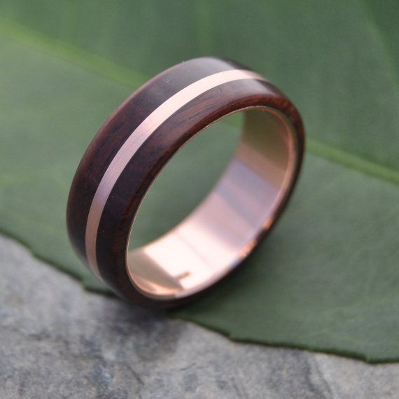 READY TO SHIP Rose Gold Solsticio Nacascolo Wood Ring size 10, 6mm Please note that this listing is for this particular size. This and other designs are available made to order in your size in our shop: http://www.naturalezanica.etsy.com  Handmade wood ring with rose gold (pink gold) and silver. This 14k rose gold version of the Solsticio design features an offset stripe of rose gold in sustainably collected brown nacascolo wood with a 14k rose gold inner band. Nacascolo wood offers a…