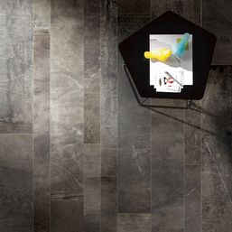 Daltile Imagica™ Midnight in 8 x 48, 6 x 48 and 4 x 48 in a random staggered brickwork pattern.