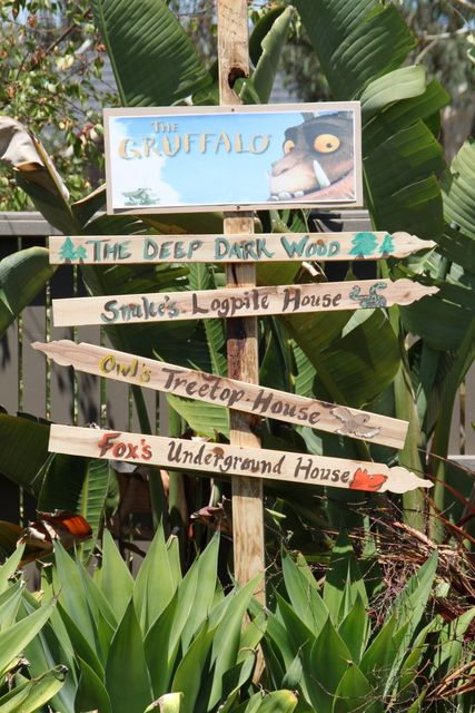 Graffalo signs! Can be done with different books... Hundred acre wood, narnia, forbidden forest, middle earth