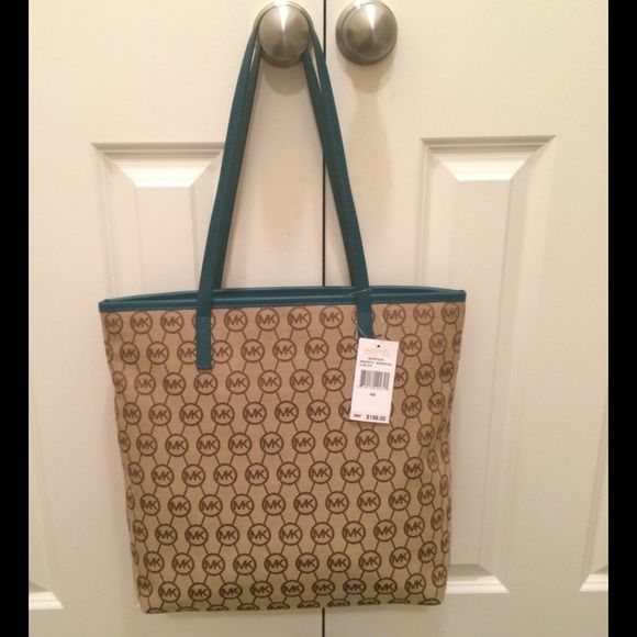 New with tags Michael Kors tote SALE New with tags Michael Kors tote purse beige and teal. Still has paper on zippers. Retail $198 + tax. Accepting reasonable offers Michael Kors Bags Totes