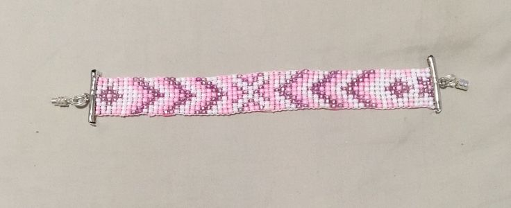 I made this pretty little bracelet for my 11 year old daughter. It's 16.5cm in length and it's 1.5cm in width across the beads but 2cm in width where the slider clasp is. Ma…