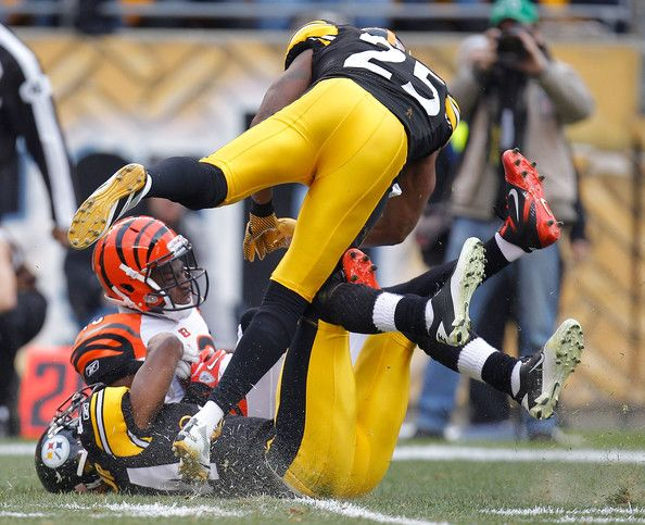 Ike Taylor Ryan Clark Photos Photos - Brandon Tate #19 of the Cincinnati Bengals is hit after a first quarter catch by Ryan Clark #25 and Ike Taylor #24 of the Pittsburgh Steelers at Heinz Field on December 4, 2011 in Pittsburgh, Pennsylvania. - Cincinnati Bengals v Pittsburgh Steelers                                                                                                                                                                                 More