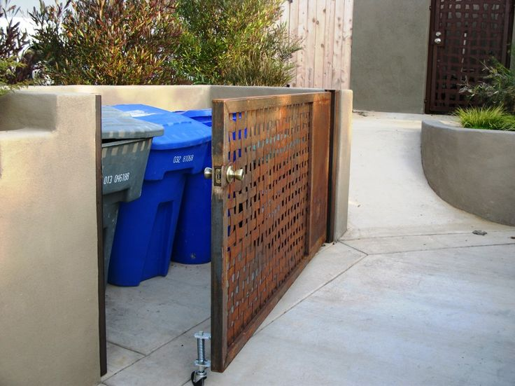 staggering Trash Can Landscape Mediterranean design ideas with driveway rusted metal gate trash enclosure utility woven metal