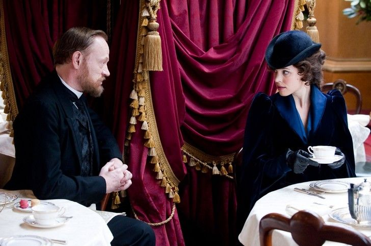 (L-r) JARED HARRIS as Dr. James Moriarty and RACHEL McADAMS as Irene Adler in Warner Bros. Pictures' and Village Roadshow Pictures' action adventure mystery 'SHERLOCK HOLMES: A GAME OF SHADOWS,' a Warner Bros. Pictures release. Photo by Christopher Raphael