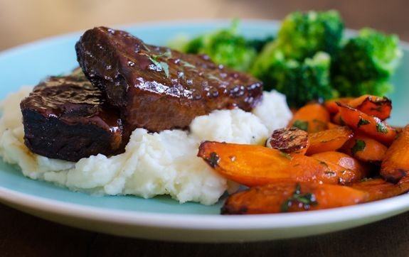 Easy Slow-Baked Boneless BBQ Short Ribs - When you're craving comfort food, you can't beat meltingly tender short ribs slow-cooked in a sweet and tangy barbecue sauce!!