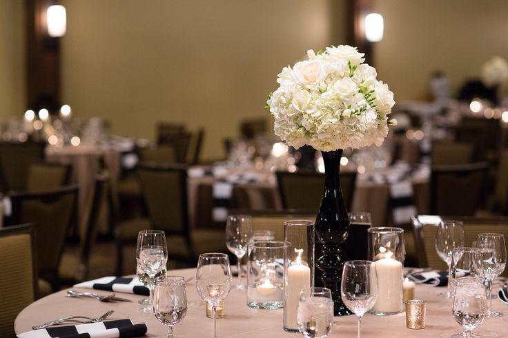Elevated white hydrangea, garden rose and freesia arrangement in a black finial vase at Silvertip Resort  Flowers by Janie- Calgary Wedding Florist www.flowersbyjanie.com  Venue: @silvertipwed  Photo: http://www.blakeloates.com