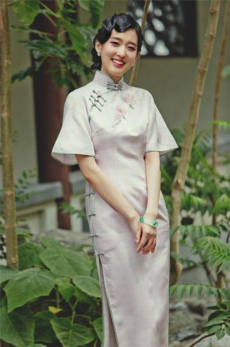 Tian Tian in a silk Mandarin dress with bell sleeves