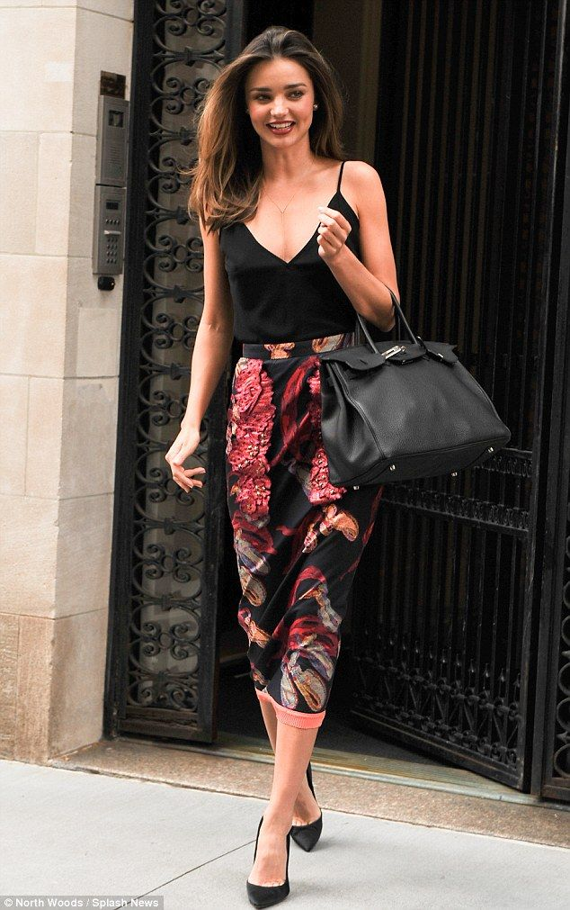 Always looking good: Miranda Kerr rocked a low cut black tank with a long floral pencil skirt for her appearance on Jimmy Fallon http://dailym.ai/1jFhQ8y