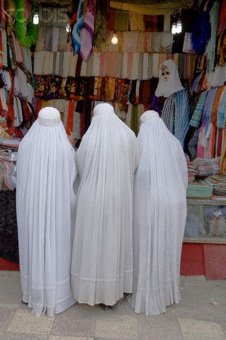 Women in burkas shopping in Mazar-e Sharif, Afghanistan.