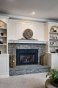 Fireplace With Stacked Stone And White Mantel Built Ins