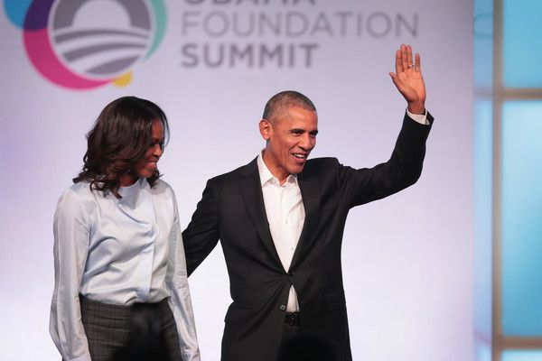 Michelle Obama Photos - Former first Lady Michelle and former president Barack Obama are introduced at the inaugural Obama Foundation Summit on October 31, 2017 in Chicago, Illinois. The two-day event will feature a mix of community leaders politicians and artists exploring creative solutions to common problems, and experiencing art, technology, and music from around the world. - Michelle Obama Photos - 22 of 9409