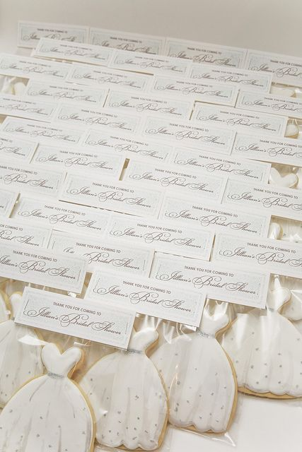 Beautiful display of bridal shower dress cookies all together and tagged with bride and grooms names. Love!