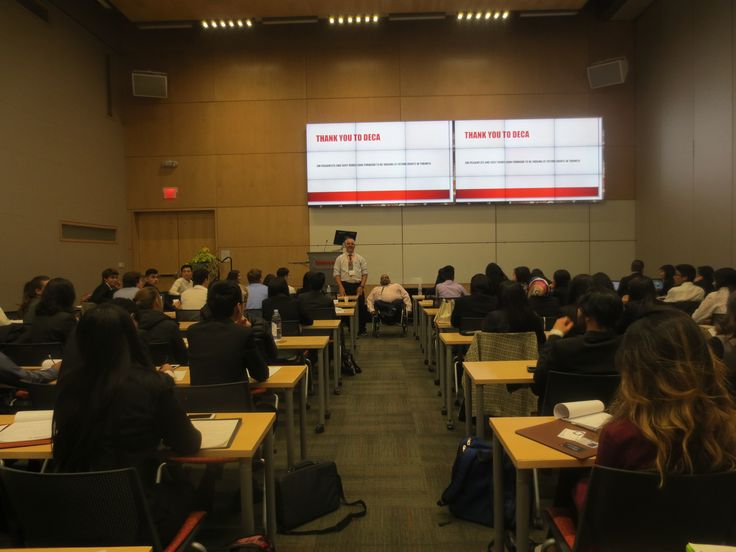 Jim pagiamtzis and Sujit Reddy speaking to full class of DECA attendees Seneca College on sunday nov 13,2016