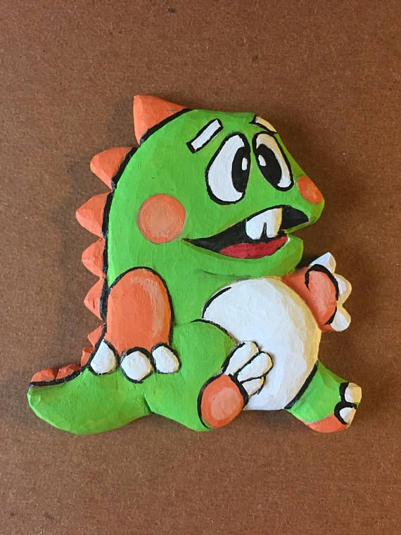 Being a true gaming geek, I have started a new line of carvings based on game characters. Check out my other carvings also. If there is a specific character you would like to see, please let me know and I will try to get one carved and added. This Bubble Bobble ornament was hand