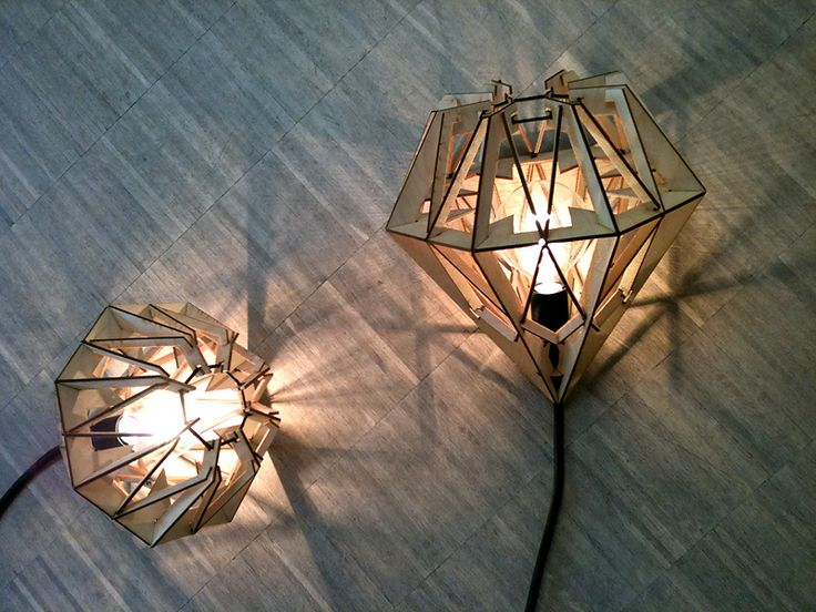 Prototype of Lamp made by Jens Vium Skaarup and Mikkeline Daa Natorp in 2010.    Consists only from 5 different shapes of laser-cut wood, 26 pieces in total. Assembled without glue only with one elastics band at the top. Three different sizes according to three standard lightbulb sizes.     Follow the image-link to see more.