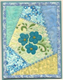 handmade quilt card ...  crazy quilt style ... looks like real material, but could be done with paper and a stitching stamp ...  lovely card ...