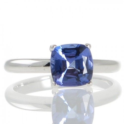 A solitaire style ring made in 18ct white gold featuring a 2.15ct faceted cushion cut tanzanite set in four fine claws that follow down the railed underbezel which is highlighted by a small chenier to either side all to a plain polished half round band. #Rutherford #Melbourne