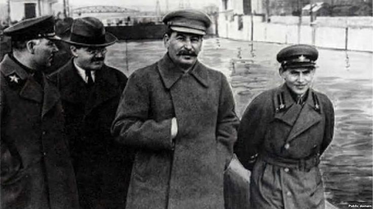 Soviet dictator Josef Stalin (center) and Soviet secret police head Nikolai Yezhov (right) walk near Moscow in 1937, the same year Yezhov signed Order No. 00447, which began the Great Terror.