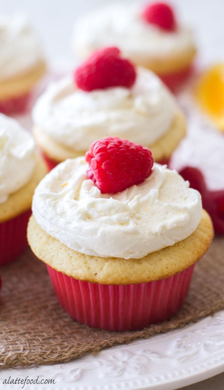 cupcake recipes for bridal shower%0A These sweet orange cupcakes are filled with a homemade raspberry cream and  topped with an orange