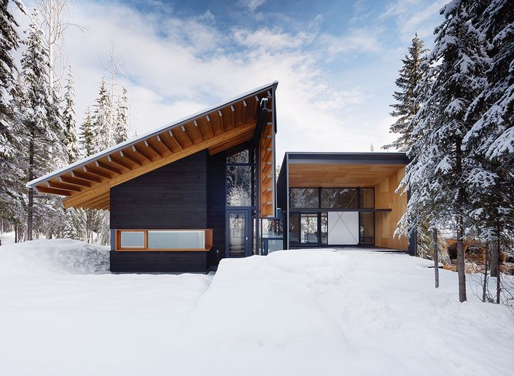 Douglas fir walls and beams extend to the exterior of a weekend house near Golden, British Columbia. Designed by Bohlin Cywinski Jackson and Bohlin Grauman Miller Architects, it was designed for an active family that likes to hit the slopes. A chalet-like pitched roof emphasizes its cabin feel.