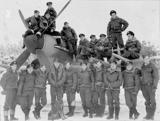 Military personnel of 438th Squadron of the Royal Canadian Air Force in Holland during the Second World War.<br />(CAVM 30781)