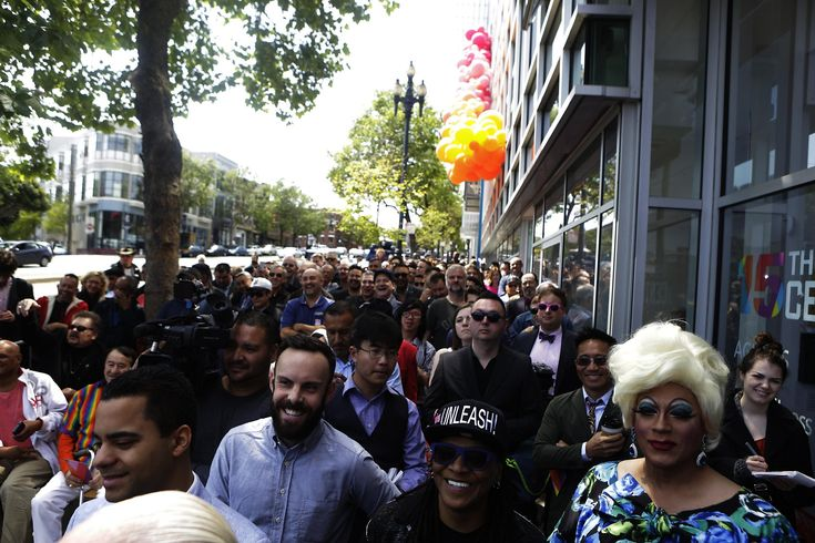 """At the ribbon cutting of the newly renovated San Francisco LGBT Center on Sunday, a throng of supporters crowded the sidewalk in front of the distinctive turquoise-and-purple building at Market Street and Octavia Boulevard as the San Francisco Lesbian/Gay Freedom Band's rendition of """"Turn the Beat Around"""" carried down the block.  The center, which was also celebrating its 15th anniversary over the weekend, serves more than 8,000 people a year, offering medical and legal services, youth…"""