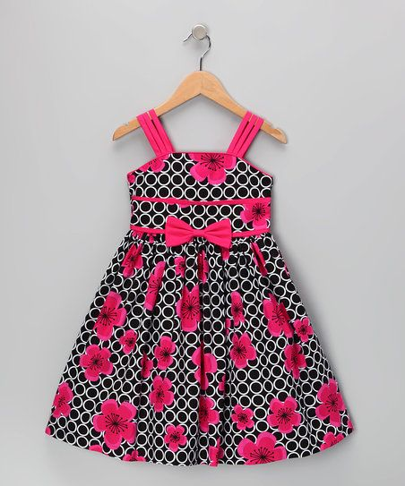 As beautiful as a rose in bloom, this elegant dress features a rich floral print, satiny lining and billowing skirt that will dance at every step, skip and sashay. The no-fuss zippered back makes this piece extra special, and the coordinating shrug adds a dash of warmth and style when the occasion calls for it.