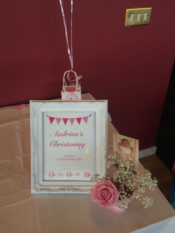 Christening buffet table decorations, frame and floral pot, bunting & elephants, balloon weight was bag with personalised tags
