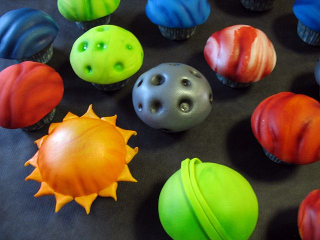 A fun variety of planet cupcakes. Fondant, textured and airbrushed.