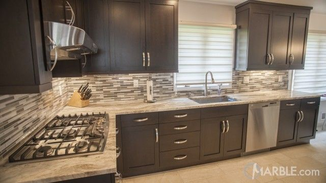 Example of Dark cabinets, light counter.  I think the counter is Fantasy Brown Granite?  Kitchen Galleries and Countertop Design Ideas.