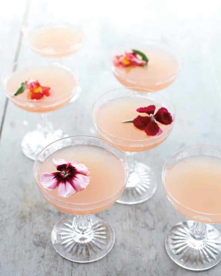 Lillet Rose Spring Cocktail 12 ounces Lillet Rose 12 ounces Ruby Red grapefruit juice 6 ounces gin     6 edible flower blossoms (optional)