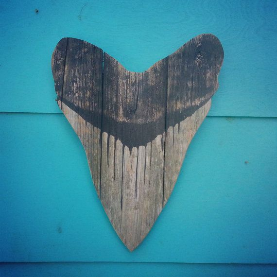 This tooth is approximately 15 inches long by 12 inches wide. It is made of recycled fence wood. Go green with your outdoor art. Each piece will be