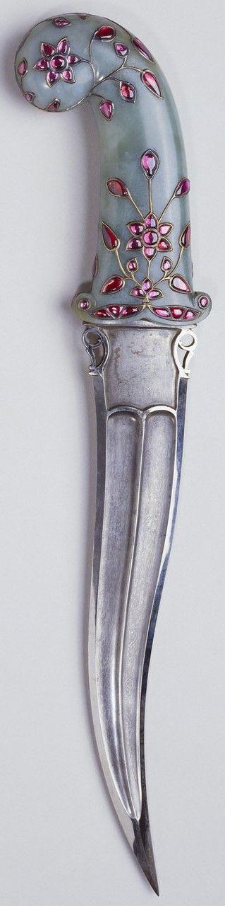 Khanjar Dagger.      Culture: Indian.     Medium: steel, white jade, gold and rubies.