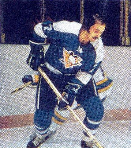 """Steve Durbano was nicknamed """"Mental Case"""" and was noted for his villainous behavior on the ice and his larger than life persona of it. Was implicated in a criminal scheme to import cocaine into Canada and was sentenced to seven years in prison. Died of liver cancer in 2002 at the age of 50."""