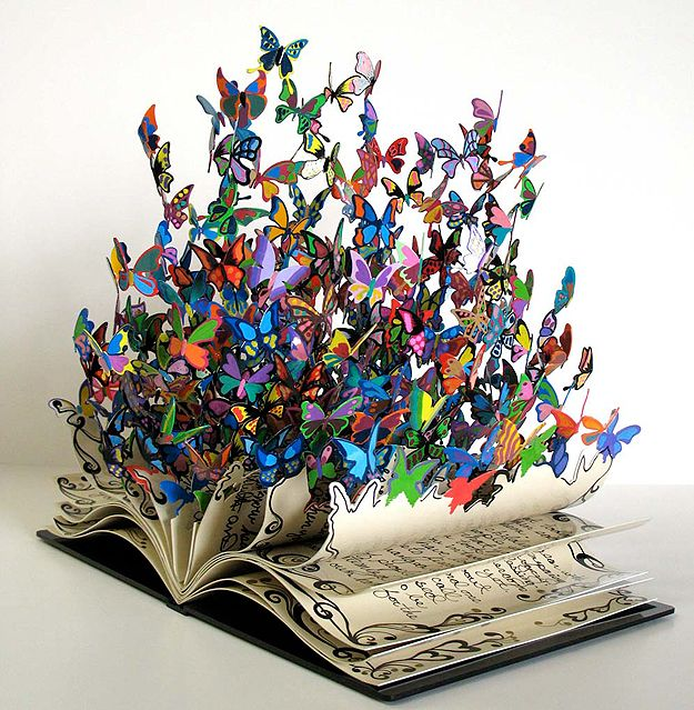 "Book of Life by David Kracov  ""David Kracov was commissioned to create this sculpture to be given in honor of Rabbi Yossi Raichik who saved over 2,500 children from the effects of the Chernobyl disaster. Each page has words from the children (who are now all grown up) whose lives he touched. These butterflies represent the children whom he gave a renewed chance at life."""