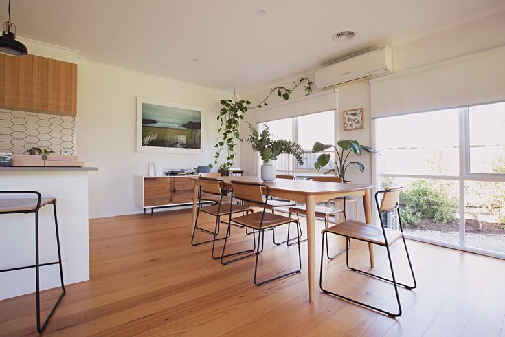 The open plan dining and kitchen has the house's original floorboards that they had re-sanded and polished.