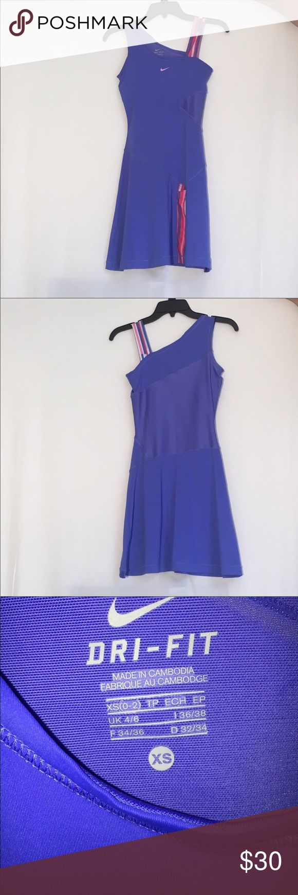 NIKE dri fit tennis golf dress Size xs only worn once in perfect condition! Beautiful blue color with built in support. Gold tennis brunching outfit! Nike Dresses