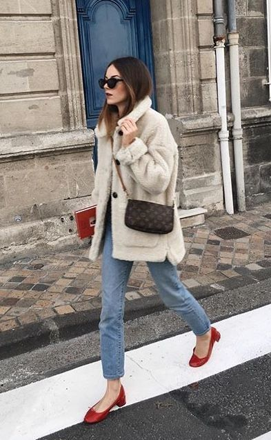 5214f872f835 Fake fur winter coat paired with denim jeans and bright red shoes. Autumn  winter 2018. mantel-Trends 2019  Das sind die Must-haves ...