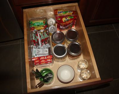 Toddler self-serve with one scoop from larger containers. All needed utensils/bowls in the drawer.
