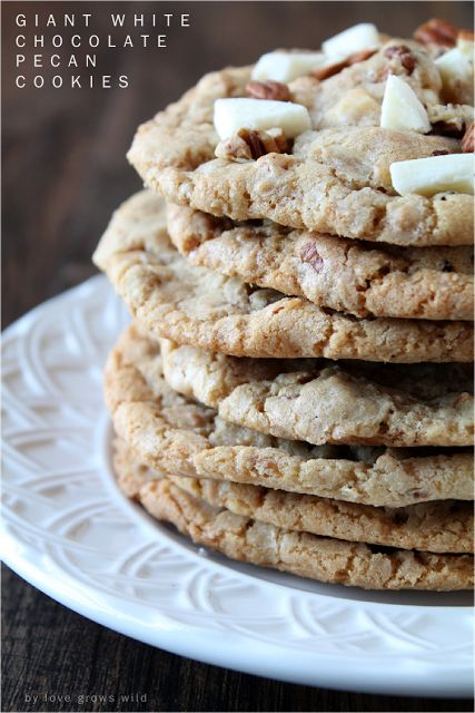 Giant White Chocolate Cookies at http://therecipecritic.com A giant cookie that gets slightly crisp on the outside but stay soft and chewy on the inside and are loaded with yummy additions!