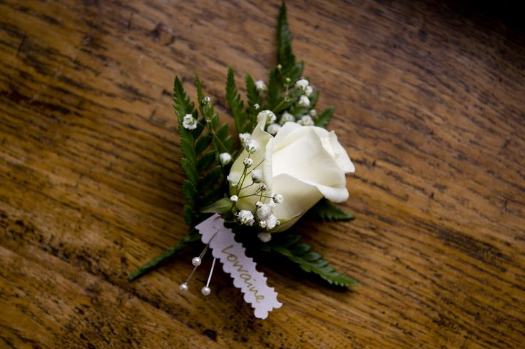 Simple ivory rose and fern corsage