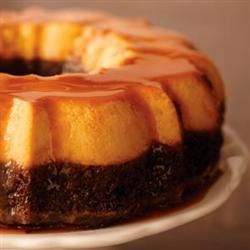 "A bundt cake with a chocolate devils food layer, topped with ""flan"" cake, then caramel sauce over all!  Oh my stars!"