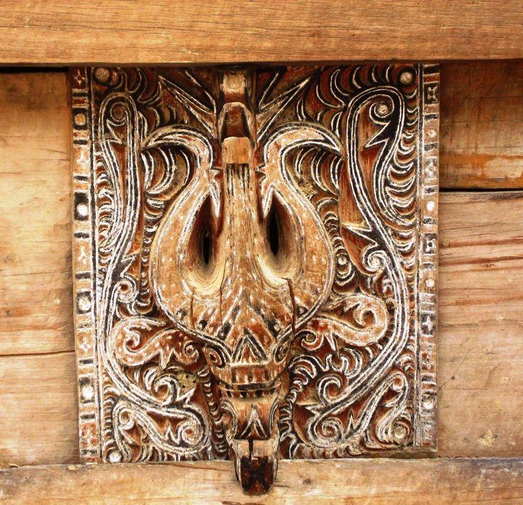 Batak country, north Sumatra. Traditional house decoration (buffalo head and…