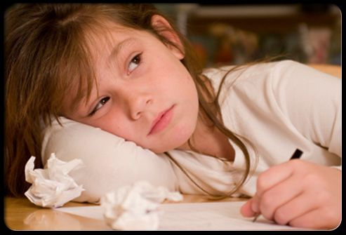Girl not motivated to finish homework.  ADHD is an ongoing behavior disorder usually diagnosed at 5 or 6.