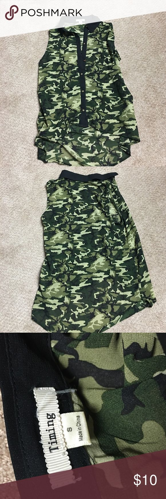 Camo top Button down collared camo blouse, never been worn. Light material, super flowy. Longer in the back. Cute with leggings. Sleeveless. I accept offers Camo Tops Button Down Shirts