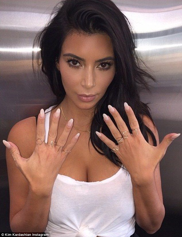 Kim Kardashian took off her wedding bling to rock a full hand of NORTH WEST rings http://dailym.ai/1s6LLbH