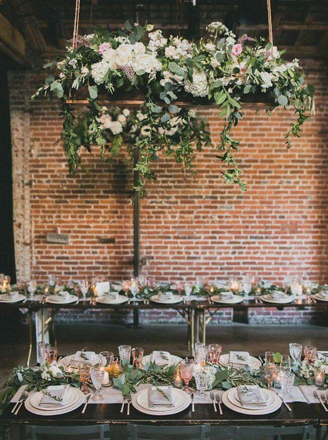 Industrial Wedding reception indoors with brick wall