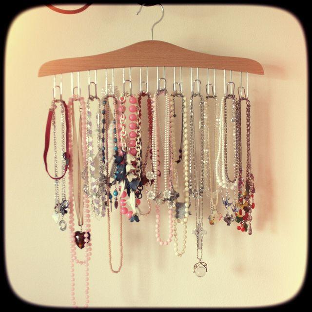 Put hooks into hanger for necklace storage
